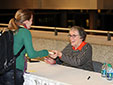 Annie Proulx signs books after an event.